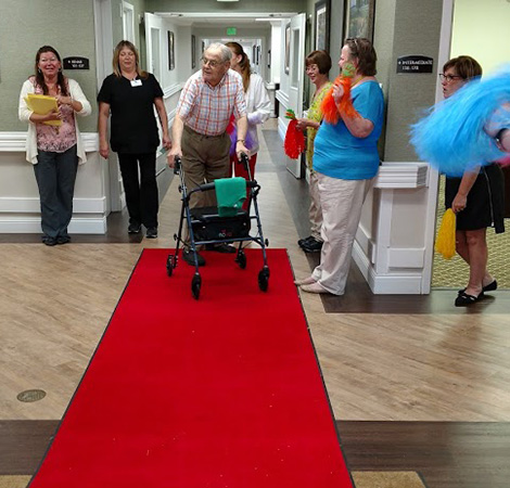 "male resident with a walker getting the ""red carpet"" successful discharge"
