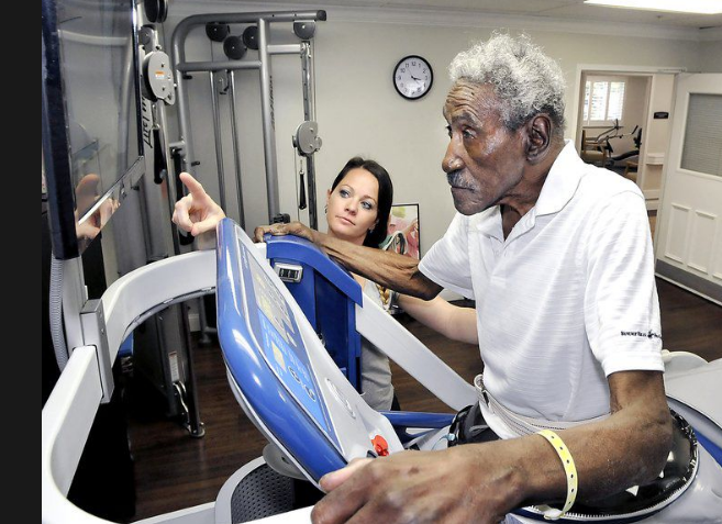elderly resident in an anti-gravity therapy machine