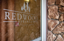 redwood springs logo on a door