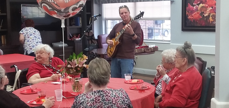 Guitar player playing on Valentine's day at the Richwood center