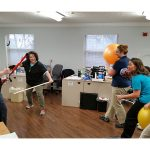 Physical therapists playing in the office with therapy equipment