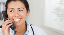 woman doctor on the phone smiling