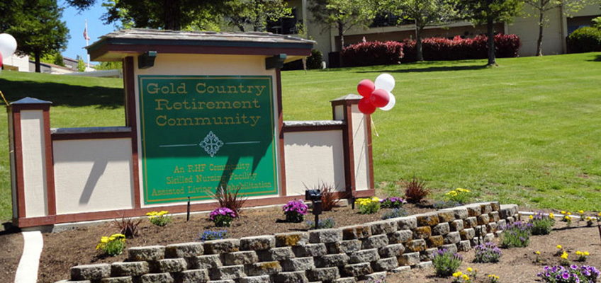 Gold Country Retirement Community sign with balloons