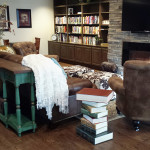 nicely appointed sitting area with many books and a flat screen tv