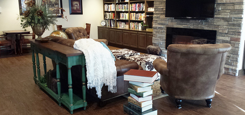 RHF Gold Country reading area with leather chairs and a fireplace