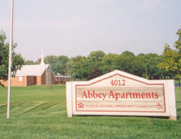abbey apartments outside sign