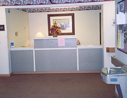 front desk area with a painting in the background