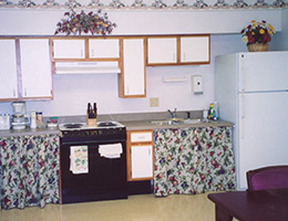 Abbey kitchen area with fun cabinets