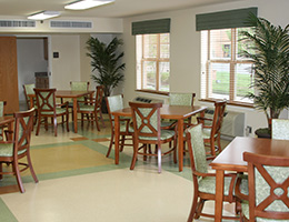 lots of wooden tables and chairs in an indoor dining area