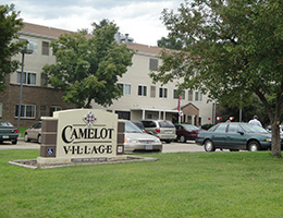 camelot village facility sign by the parking lot