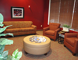 Carlin lobby with sofas chairs and a circular ottoman