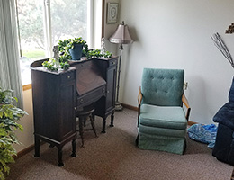 cozy indoor sitting area with a chair and desk