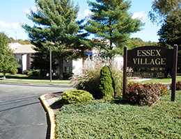 Essex Village wooden sign
