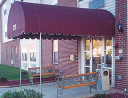 Front of the building with a red awning