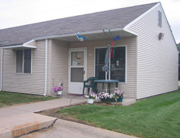 Great Plains Community showing an entrance to a home with plants and decorations out front