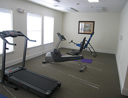 gym area with treadmill and bike