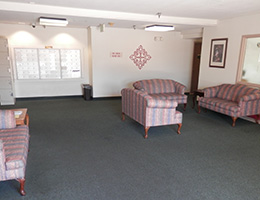 La Mirada waiting area with multiple couches and RHF logo on the wall