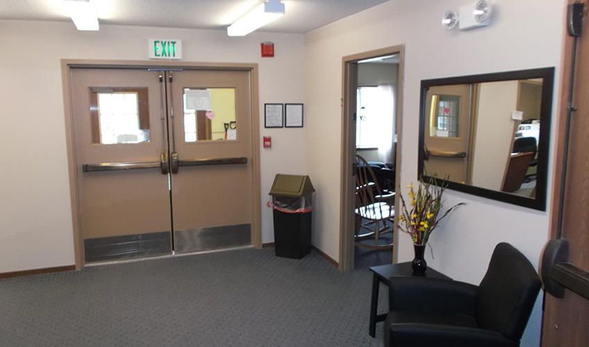Sitting area with double doors leading to the residents and entrance to a room