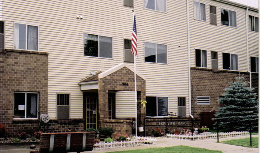 Lakeview Manor tiled entrance with American flag out front