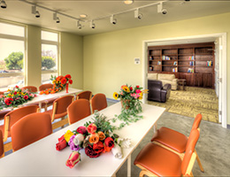 Las Alturas flower arrangements and reading library and lounge