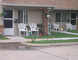 Loess Hills Estates community with screen door and seating out front