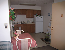 Loess Hills Estates apartment with kitchen area and seating