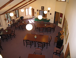 Manona Meadows recreation room with seating and a game table up front