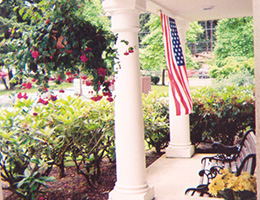 Marymount Manor porch with US flag