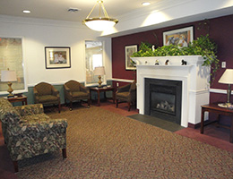 lobby area with large fireplace