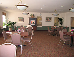 dining area with many tables and chairs and plants