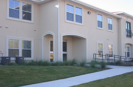 outside of facility with a nice lawn and clean exterior