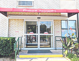 Pinehurst Apartments front entrance with awning