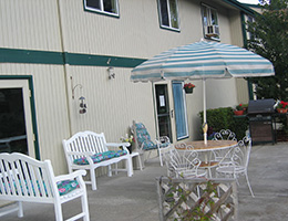 Pinewood Manor outdoor patio with benches and tables
