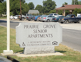 prarie grove senior apartments facility sign on the street