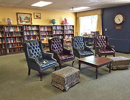 Library room with chairs and tables in front