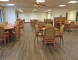 Resident dining area with wood floors
