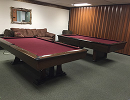 Two pool tables in an activity room