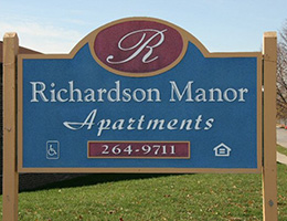 Richardson Manor Apartments sign out front