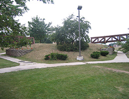 Richardson Manor walking trails with wood bridge and planters in various spots