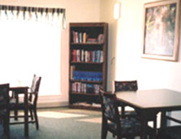 tables and seating with a small shelf of books