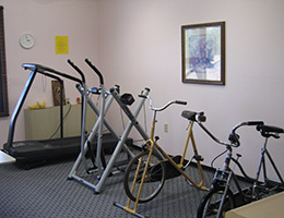 Westover Manor exercise room with treadmill and exercise bikes