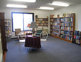 Westrover Manor library with seating and several shelves, bookcases of books