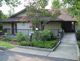 Redding Butte community with walkway and trees out front