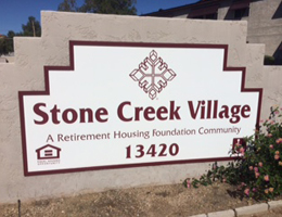 Stone Creek Village exterior sign mounted on stone