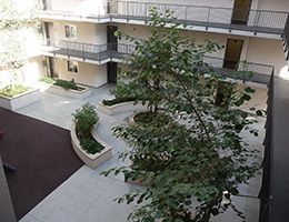 Bonnie Brae aerial view of courtyard with planters and mature trees
