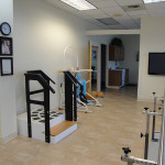 RHF Bixby Knolls exercise room with equipment and flat screen TV