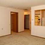 One of the communities floor plans showing the closet, kitchen and bedroom door open