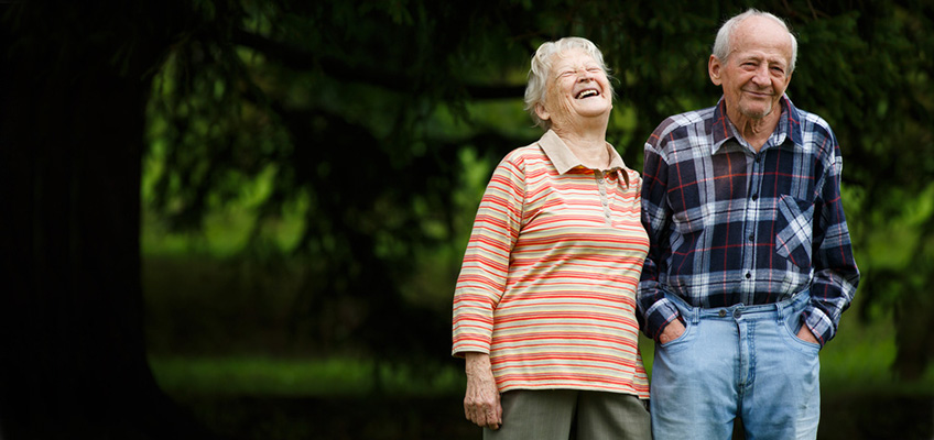man and a woman taking a walk outside laughing and smiling