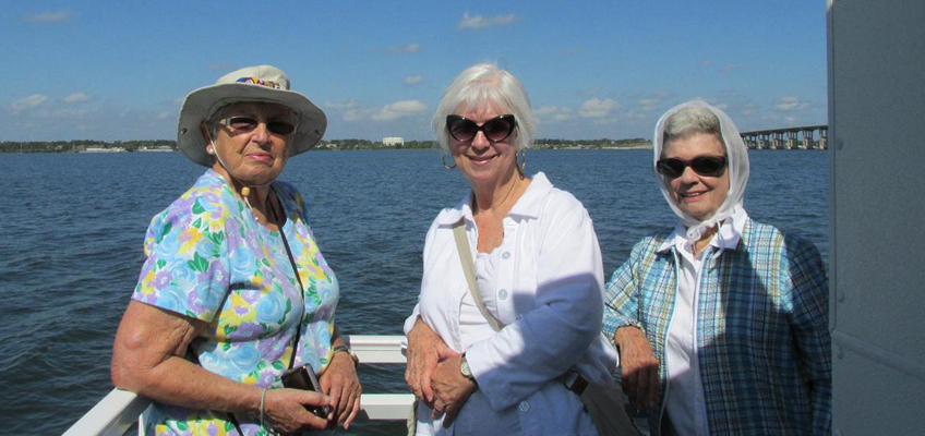 3 Women enjoying an afternoon on the river boat
