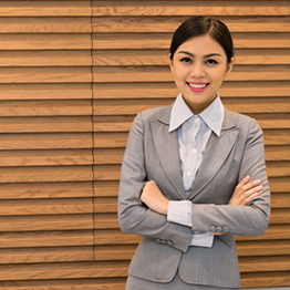 smiling woman dressed in a business suit